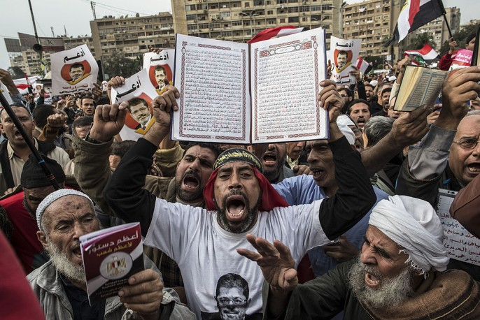 Muslim Brotherhood Members chant slogans during a rally on December 14, 2012 in Cairo.