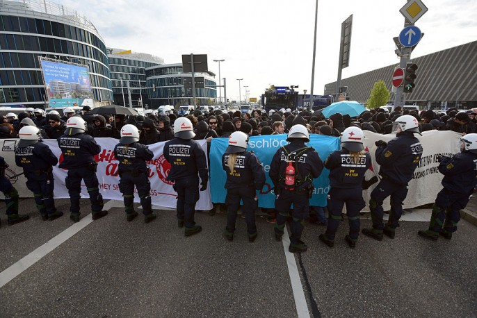 Anti-AFD demonstrators and police forces face near the AfD (Alternative fuer Deutschland) party's federal congress at the Stuttgart Congress Centre ICS on April 30, 2016 in Stuttgart, Germany.