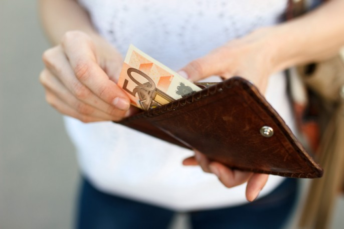 Girl is taking out money from wallet