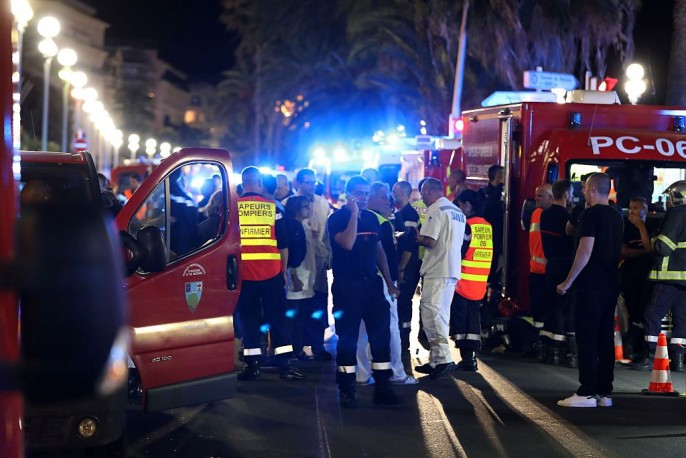 Police officers, firefighters and rescue workers are seen at the site of an attack on the Promenade des Anglais on July 15, 2016, after a truck drove into a crowd watching a fireworks display in the French Riviera town of Nice.