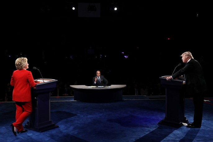Republican presidential nominee Donald Trump (R) debates Democratic presidential nominee Hillary Clinton as Moderator Lester Holt (C) looks on during the Presidential Debate at Hofstra University on September 26, 2016 in Hempstead, New York.