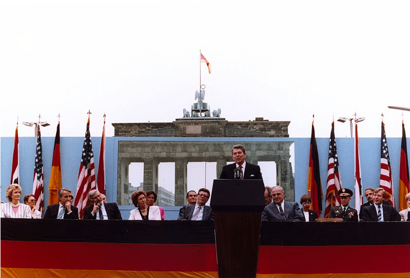 Ronald Reagan speaking in front of the Brandenburg Gate and the Berlin Wall on June 12, 1987
